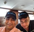 Manoj sir and his friend wear cap.